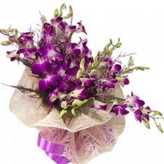 Stunning Purple Orchid Flower Bouquet  10 purple orchids wrapped in cellophane and tied in fancy ...